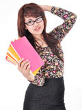 Woman smiling and posing carrying books. Isolated on white background Stock Photography