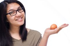 Woman and egg Royalty Free Stock Photo
