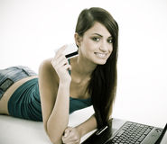 Woman smiling showing the credit card Stock Images