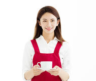 Woman smiling and showing cup of coffee Royalty Free Stock Photos