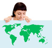 Woman smiling showing earth globe on billboard Stock Images