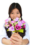 Woman smiling and showing flowers Stock Image