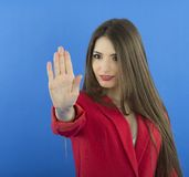 Woman smiling and showing his hand in signal of stop Royalty Free Stock Images