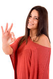 Woman smiling and showing OK sign Stock Images