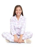 Woman smiling sitting in pajamas Stock Photos