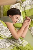 Woman smiling in sleep stock photo