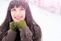 Woman smiling in snow portrait Royalty Free Stock Images