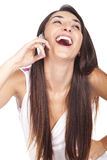 Woman smiling and speaking at her celular Royalty Free Stock Photos