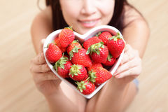 Woman smiling with strawberry Royalty Free Stock Photography