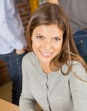 Woman Smiling With Students Standing In Background Stock Photos