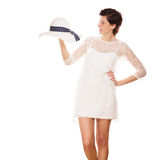 Woman smiling at a sun hat in her hand Royalty Free Stock Images