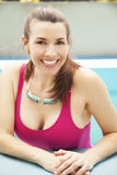 Woman smiling in swimming pool Stock Image