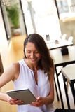 Woman smiling at tablet Royalty Free Stock Photo