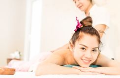 Woman is smiling while taking massage in Thai spa. Happy women is smiling while taking massage in Thai spa stock images