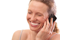 Woman smiling and talking on the telephone Stock Photography