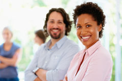 Woman smiling with team in background Royalty Free Stock Photo