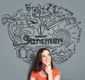 Woman smiling thinking of her summer vacation Royalty Free Stock Photography