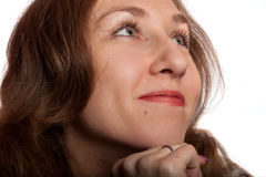 Woman  smiling thoughtfully Royalty Free Stock Images