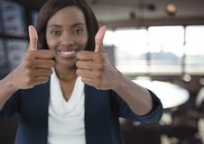 woman smiling with thumbs up stock photos