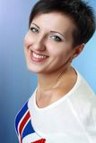 Woman smiling to the camera Stock Images