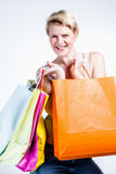 Woman smiling to the camera  holding bags Stock Photo
