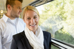 Woman smiling in train man selective focus stock images