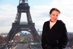 Woman smiling, view of Eiffel Tower at winter Stock Photography