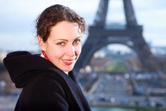 Woman smiling, view of Eiffel Tower at winter Royalty Free Stock Image