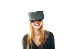 Woman smiling in virtual reality helmet Stock Photo