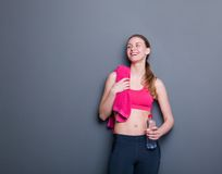 Woman smiling with water bottle Stock Photos