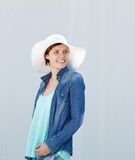 Woman smiling with white sun hat Royalty Free Stock Photos