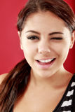 Woman smiling and winking Stock Photography