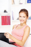Woman smiling while working on laptop Royalty Free Stock Photography