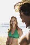 Woman Smiling At Young Man At Beach Royalty Free Stock Images