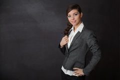Woman smilining blackboard