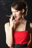 Woman and smoke Royalty Free Stock Images