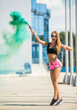 Woman with smoke bomb Royalty Free Stock Photography