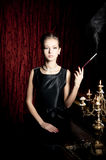 Woman, smoke with cigarette holder, retro style Stock Photography