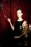 Woman, smoke with cigarette holder, retro style Stock Photo