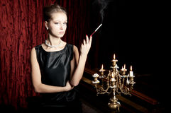 Woman, smoke with cigarette holder, retro style Stock Image