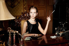 Woman, smoke with cigarette holder, retro style. Woman, smoke with cigarette holder Stock Photos