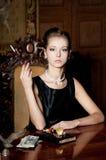 Woman, smoke with cigarette holder, retro style Royalty Free Stock Photos