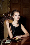 Woman, smoke with cigarette holder, retro style Royalty Free Stock Image