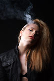 Woman with smoke Royalty Free Stock Images