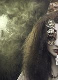 Woman and smoke. Stock Photos