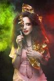 Woman and smoke. Stock Image