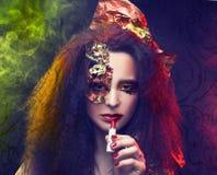 Woman and smoke. Stock Images