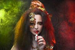 Woman and smoke. Royalty Free Stock Photography