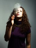 Woman smokes Royalty Free Stock Photography