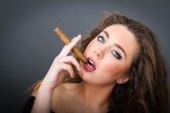 Woman smokes cigar Royalty Free Stock Photos